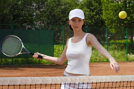 sheen: Girl return a tennis ball