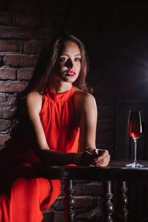 Sad woman drink wine at he tavern