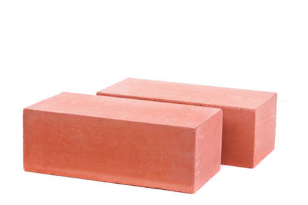 Two red ceramic bricks at the white background, isolated