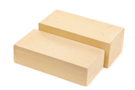 Two yellow ceramic bricks at the white background, isolated Stok Fotoğraf