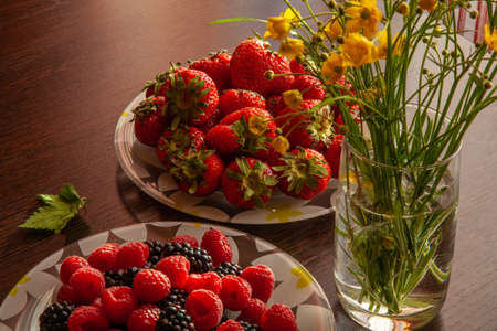 Very tasty food -Strawberry and raspberry and flowers nature morte