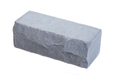Grey relief ceramic brick at the white background, isolated