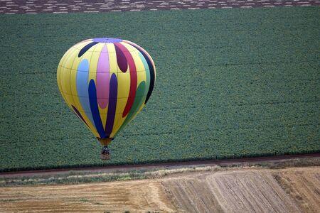 A hot air balloon above fields landscape Stock Photo - 7320125