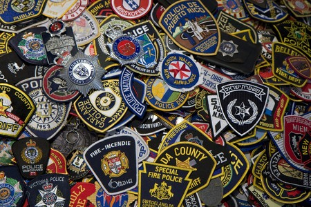 Heap of police and firemen badges