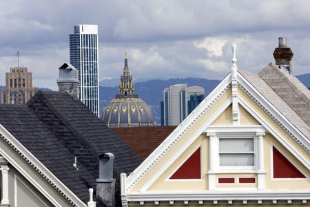 Roofs of San Francisco with Victorian houses in front photo