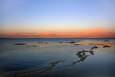 The water of the dead sea with the Jordan mountains at sunset Stock Photo - 7544213