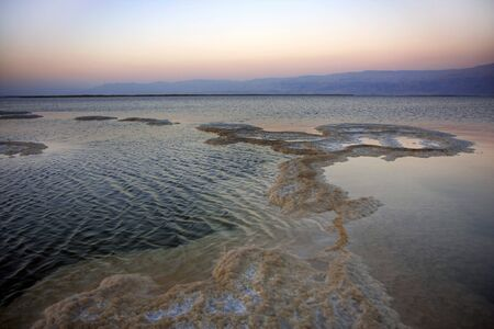 death valley: The water of the dead sea with the Jordan mountains at sunset