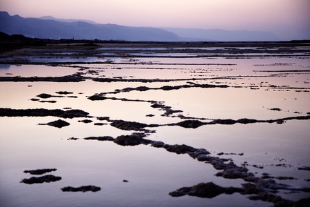 The water of the dead sea with the Jordan mountains at sunset photo
