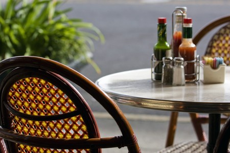 Restaurant table and chairs with salt and pepper Stock Photo