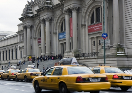 Taxi cars in front of the Metropolitan Museum in New York photo