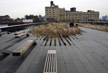 High Line park in Manhattan, New York with the city layers and a bench