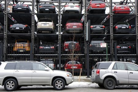 cars parking: New York City multi story automated parking lots filled with cars next to the High Line Stock Photo