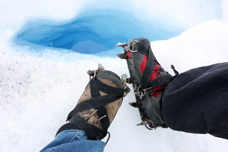 crampons: Glacier trecking crampons on boots  in Perito Moreno in Patagonia Stock Photo