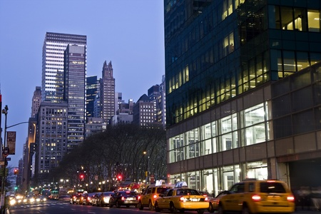 bryant park: Traffic next to Bryant park in the midtown Manhattan at night  Editorial