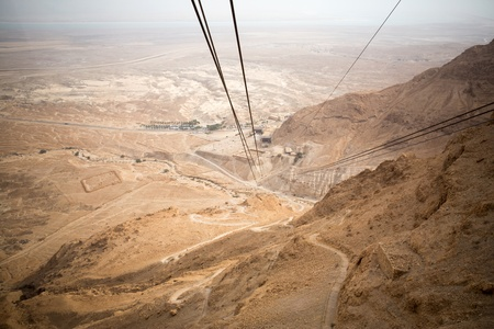 View of the Dead Sea and the cable car to the  Masada fortress, Israel photo