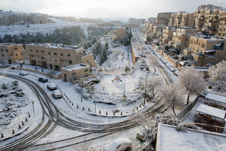 Jerusalem neighborhood and forest after a snow storm  Stock Photo