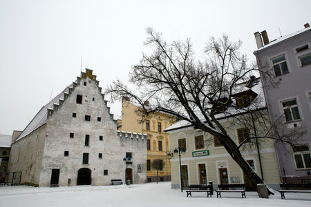 Small houses under snow in old city of Ceske Budejovice Editorial