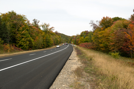 hampshire: Road in New Hampshire and the forest at fall time