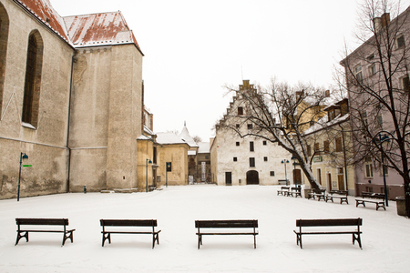 budweis: Small houses under snow in old city of Ceske Budejovice Stock Photo