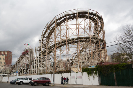 Cyclone wooden roller coaster in the amusement park in the Coney Island, New York