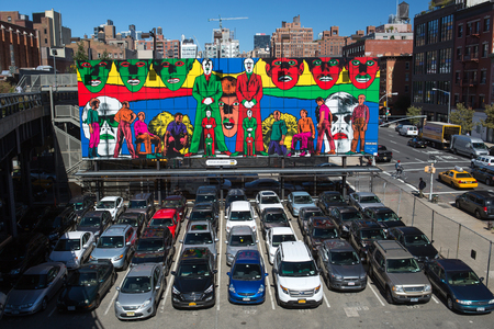 new car lots: New York City multi story automated parking lots filled with cars next to the High Line Editorial