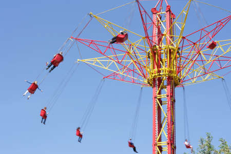 People ride on extreme high carousel tower