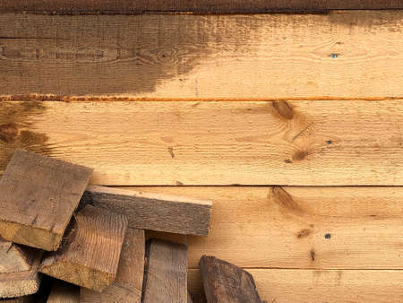 Background of wooden boards, wooden walls, saws.