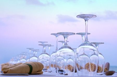 festively: Festively decorated table with glasses against the evening sky