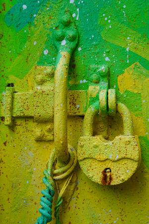 green door: Bright green door lock Stock Photo