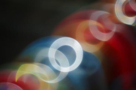 chatoyant: Chain lens flares iridescent shine diagonally on a black background