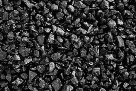 Black Stones background. Abstract texture with copy space.