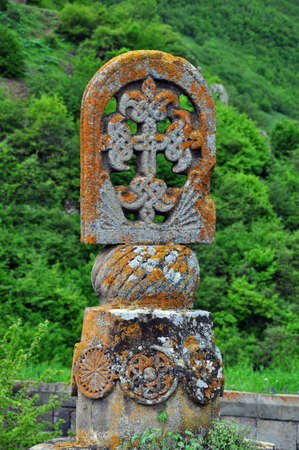 tatev: Gavazan tilting column, built in 904. This octagonal stone pillar has eight meters high,topped with a cross.