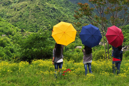 Armenian Girls opened colorful umbrellas in the mountains photo