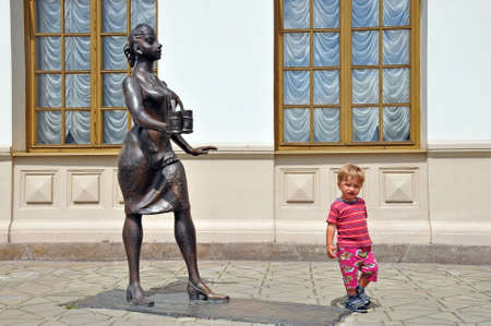 conductors: Sculpture conductors and the child, in the historic part of the railway station in Ekaterinburg, Russia Stock Photo
