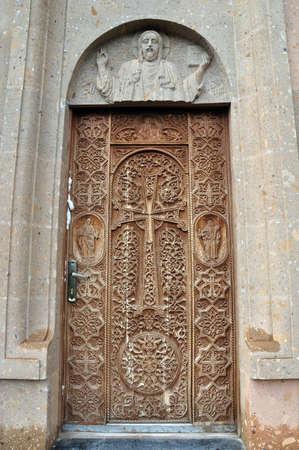wooden cross: Beautiful wooden door in the new church, Jermuk, Armenia Stock Photo