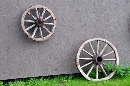 old wood farm wagon: The old wheel is used to create the interior. Horse stable