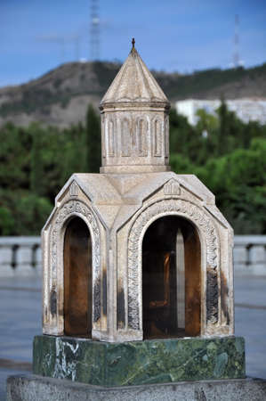 sacred trinity: miniature church. yard The Holy Trinity Cathedral of Tbilisi , Sameba. Georgia Stock Photo