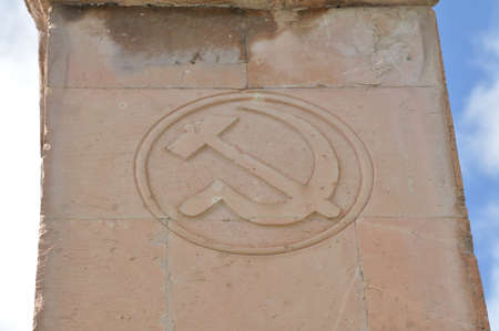 hammer and sickle: Soviet symbol hammer and sickle  carved into the tuff. Armenia, Odzun.
