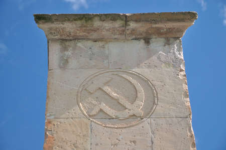 communism: Soviet symbol hammer and sickle  carved into the tuff. Armenia, Odzun.