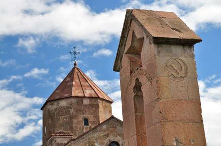 dictatorship: Armenian temple Odzun and Soviet symbols coat of arms and star Editorial
