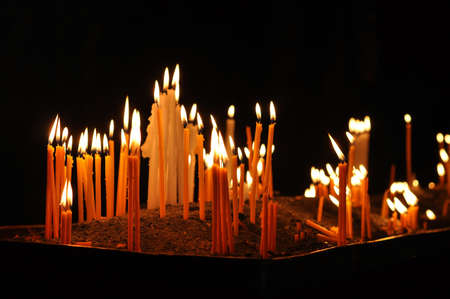 candles in church . geghard monastery Armenia