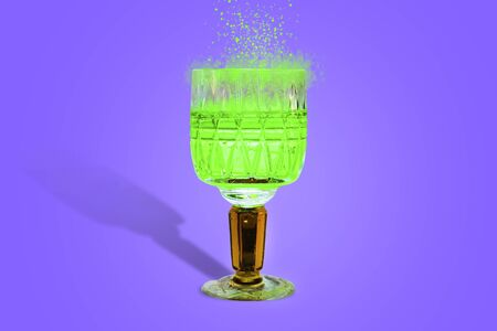 magic potion green sparks in a crystal glass blue background