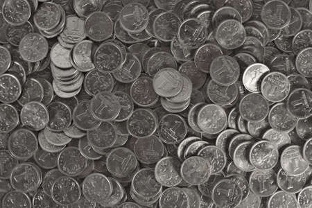 Background from silver coins. Loose of coins. photo