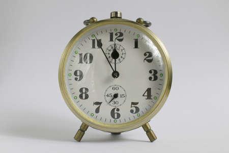 Old alarm clock isolated on white  photo