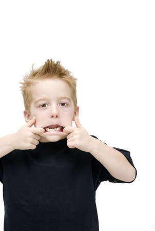 young boy pulling a face photo