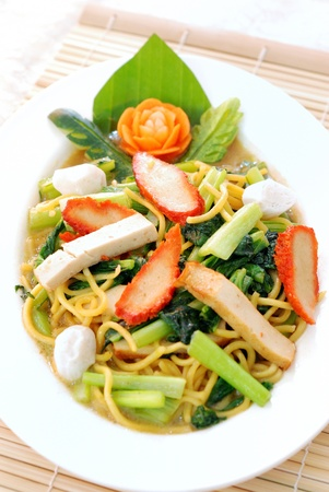 stir up: close up Chinese stir fried noodle in white plate