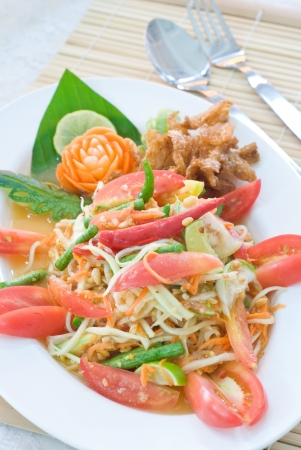 famous Thai cuisine papaya salad in white dish photo