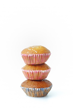 isolated stack of three banana cup cake on white background photo