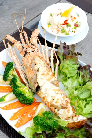 close up baked lobster with cheese serves with rice photo
