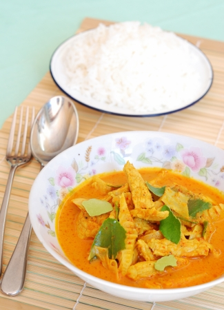 close up homemade pork and bamboo shoot curry with rice dish photo